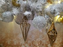 Embellished Christmas tree decoration gold ornament, frosted hanging ball, star and tinsel Stock Images