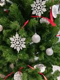 Embellished Christmas tree decoration hanging ball, snowflake and ornaments Royalty Free Stock Photography