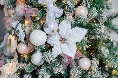 Embellished Christmas tree decoration white flower. Close-up Stock Image