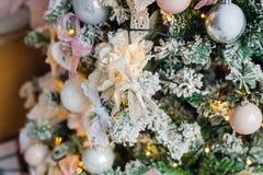 Embellished Christmas tree decoration white flower. Close-up Royalty Free Stock Photos
