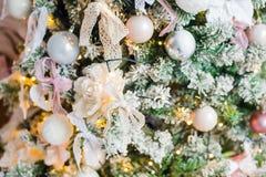 Embellished Christmas tree decoration white flower. Close-up Stock Photo