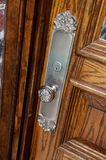 Embellished metal door knob. A close up image of a metal door knob Stock Photography