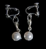 Embellishment from handmade pearl. On black Royalty Free Stock Photos
