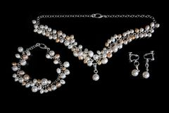 Embellishment from handmade pearl. On black Stock Images