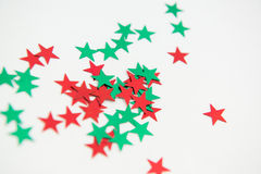 Embellishment Holiday Stars. Green and red embellishment holiday stars. Red and green colourful metallic star embellishments isolated on white background Royalty Free Stock Photo