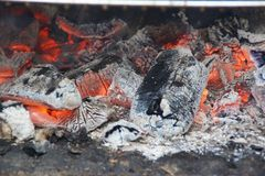 Embers - Front view. Embers are burning coals stemming from the combustion of wood, from coal, or from another material established constituted by carbon carried Stock Photo