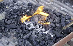 Embers of coal with fire Royalty Free Stock Images