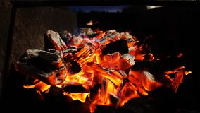 Embers fire fireplace grill fire flame, black background royalty free stock photo