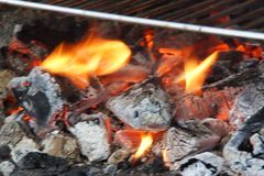 Embers and fire - Front view and horizontal. Embers are burning coals stemming from the combustion of wood, from coal, or from another material established Stock Images