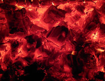 Embers and the fire in the stove in Russian Karelia. Royalty Free Stock Photo
