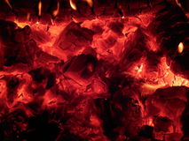 Embers and the fire in the stove in Russian Karelia. Stock Photos