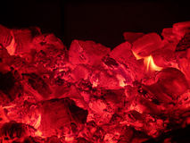 Embers and the fire in the stove in Russian Karelia. Royalty Free Stock Photography