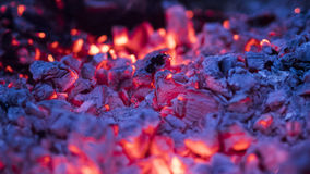 Embers glowing. The embers are still glowing after the flames have gone stock photos