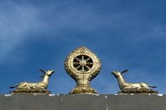 Emblème bouddhiste de cerfs communs Images stock