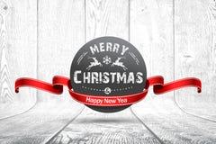 Emblème de Noël sur la texture en bois Photographie stock libre de droits