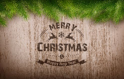 Emblème de Noël sur la texture en bois Photo stock