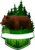 Emblème de région boisée de vecteur avec l'ours gris brun Images stock
