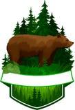 Emblème de région boisée de vecteur avec l'ours gris brun Images libres de droits