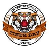 Emblème international de Tiger Day avec le chef fâché de tigre Image libre de droits