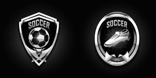 Emblèmes de chrome du football Photo libre de droits
