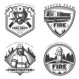 Emblèmes de lutte contre l'incendie de vintage réglés illustration libre de droits