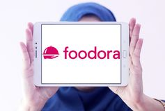 Embleem van het de leveringsbedrijf van het Foodora het online voedsel Stock Afbeeldingen
