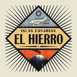 Emblem with airplane, volcano and text El Hierro, Canary island. Stamp or vintage emblem with airplane, volcano and text El Hierro, Canary island in spanish Royalty Free Stock Image