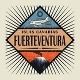 Emblem with airplane, volcano and text Fuerteventura, Canary isl. Stamp or vintage emblem with airplane, volcano and text Fuerteventura, Canary island in spanish Stock Photography