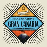 Emblem with airplane, volcano and text Gran Canaria, Canary isla. Stamp or vintage emblem with airplane, volcano and text Gran Canaria, Canary island in spanish Royalty Free Stock Images