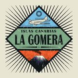 Emblem with airplane, volcano and text La Gomera, Canary island. Stamp or vintage emblem with airplane, volcano and text La Gomera, Canary island in spanish Stock Photography