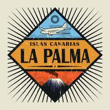 Emblem with airplane, volcano and text La Palma, Canary island. Stamp or vintage emblem with airplane, volcano and text La Palma, Canary island in spanish Stock Photo
