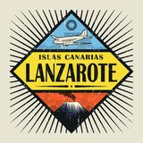 Emblem with airplane, volcano and text Lanzarote, Canary island. Stamp or vintage emblem with airplane, volcano and text Lanzarote, Canary island in spanish Stock Photo