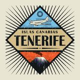 Emblem with airplane, volcano and text Tenerife, Canary island. Stamp or vintage emblem with airplane, volcano and text Tenerife, Canary island in spanish Royalty Free Stock Photo