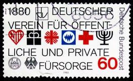 Emblem av föreningsmedlemmar, tysk anslutning av välfärdssamhälleserie, circa 1980 arkivbilder