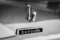 Emblem of the car styling studio Bertone on the sports car Maserati Khamsin Stock Photos