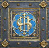 Emblem on the doors of church Stock Photo