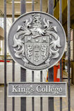 Emblem on the entrance gate of King's College in London, UK Royalty Free Stock Photos