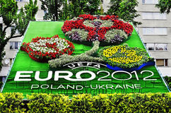 Emblem of the Euro-2012. In the center of Lviv opened phyto-panel with symbols of Euro 2012 on May 23, 2012 in Lviv, Ukraine Royalty Free Stock Photography