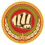 Emblem with fist. Royalty Free Stock Photography