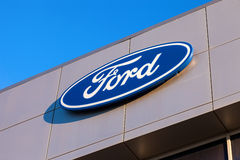 The emblem Ford on the office of official dealer. Royalty Free Stock Images