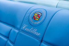 Emblem in the form of embroidery on the seat-cover of a full-size personal luxury car Cadillac Eldorado. Stock Photo