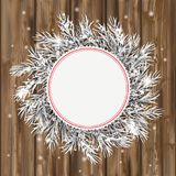 Frozen Twigs Red Emblem Snow Golden Deco Wood. Emblem with frozen twigs, snow and golden deco on the wooden background Stock Image
