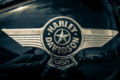 The emblem on the fuel tank of motorcycle Harley Davidson Softail. Stock Photography