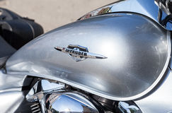 The emblem on the fuel tank of a motorcycle Suzuki Intruder clos Royalty Free Stock Image
