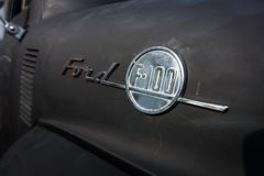 Emblem of the full-size pickup truck Ford F100. Stock Image