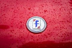 Emblem of the Italian carrozzeria Pininfarina on the Fiat 124 Sport Spider in raindrops. BERLIN - MAY 13, 2017: Emblem of the Italian carrozzeria Pininfarina on Stock Images