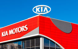 Emblem KIA motors on the blue sky background Stock Image