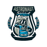 Emblem, logo, an astronaut salutes and holds a flag. Flight to the moon, space, intergalactic journey, universe, shield Royalty Free Stock Photography