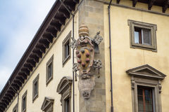 The Emblem of Medici on the historical building in Florence, Italy. Architectural and heraldry details the Emblem of Medici Family on old house in Florence stock photo