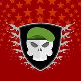 Emblem Military . Skull beret with weapons. Stock Photos